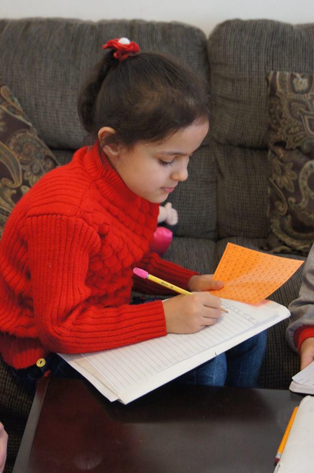 Shahd, 7, finishing her homework.