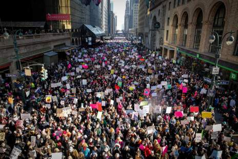 Protestors walk down 42nd Street near Grand Central Terminal during the Women's March in New York City at Dag Hammarskjold Plaza. NYTMARCH                              NYTCREDIT: Nicole Craine for The New York Times